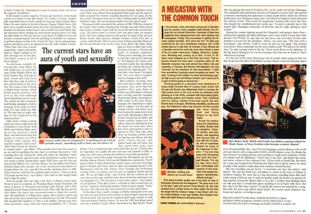 Article Preview: A MEGASTAR WITH THE COMMON TOUCH, November 1993 | Maclean's