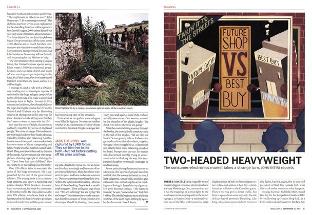 Article Preview: TWO-HEADED HEAVYWEIGHT, September 2003 | Maclean's