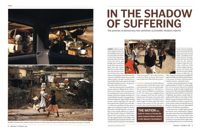 Article Preview: IN THE SHADOW OF SUFFERING, October 2003 | Maclean's