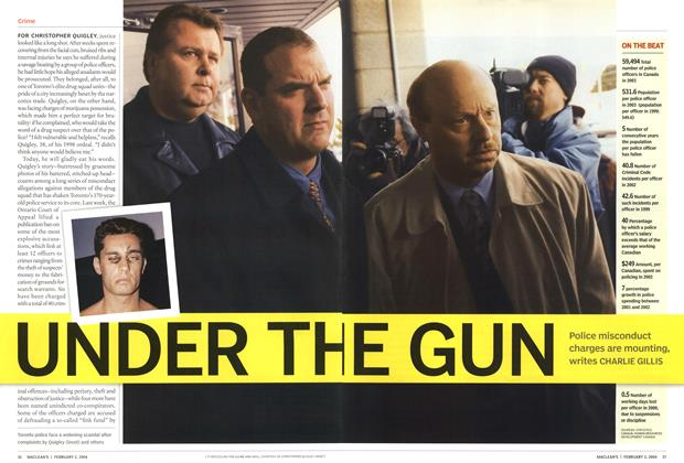 Article Preview: UNDER THE GUN, February 2004 | Maclean's
